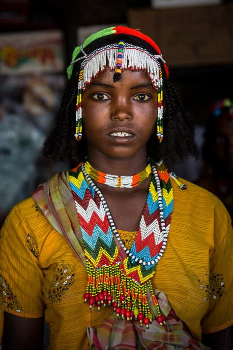 Oromo beautiful girl with colorful necklaces near asebe Te